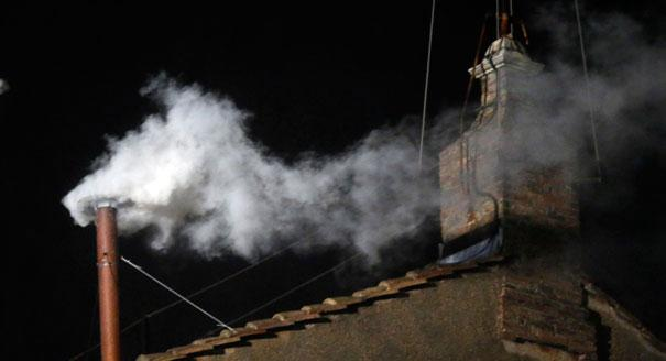 White smoke emerges from the chimney on the roof of the Sistine Chapel, in Saint Peter's Square at the Vatican on March 13. The white smoke indicates that the new pope has been elected. | AP Photo